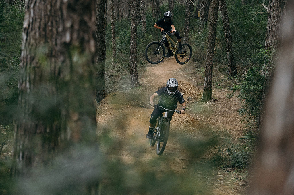 two buddies going down the hill on some trails in malaga